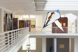 Kites hanging above the atrium painted by El Hadji Sy. Courtesy of National Gallery Prague