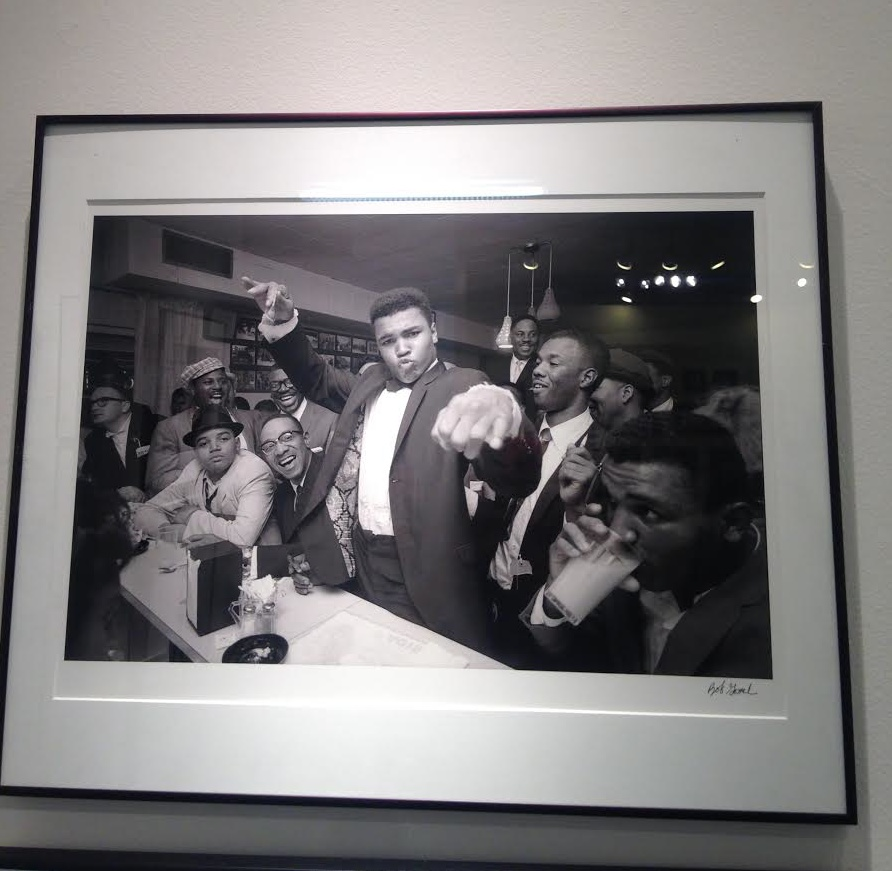 "Bob Gomel ""Cassius Clay (Muhammad Ali) victory party after he defeated Sonny Liston for the Heavyweight Championship"", 1964 - Courtesy Monroe Gallery"